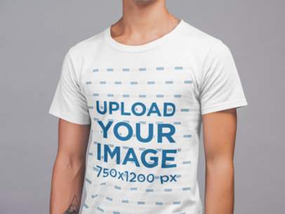 Mockup of a Cropped Face Man Wearing a Round Neck Tshirt in a Studio 21569