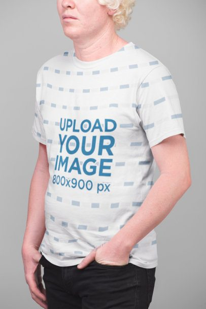 Mockup of a Serious Man Wearing a Sublimated Tshirt Against a Flat Background 22217