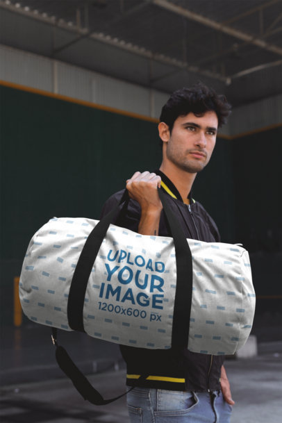 Gym Bag Mockup Featuring a Handsome Man Carrying the Gym Bag 23245