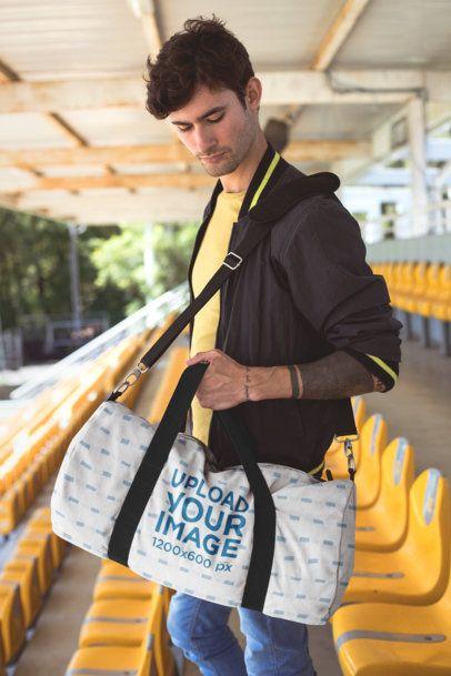 Mockup of a Man Carrying a Duffel Bag at a Stadium 23250