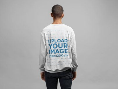Crewneck Sweatshirt Back View Mockup Featuring a Short-Haired Man in a Studio 21590