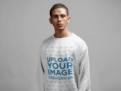 Mockup of a Serious Short-Haired Man Wearing a Sweatshirt in a Photo Studio 21592