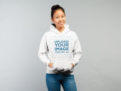Hoodie Mockup Featuring a Woman in a Casual Look Against a White Background 21770