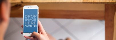 iPhone Mockup Featuring a Woman Using an iPhone 6 at Home a4290