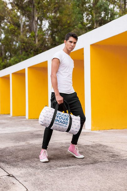 Mockup of a Serious Man Carrying a Gym Bag Outdoors 23228