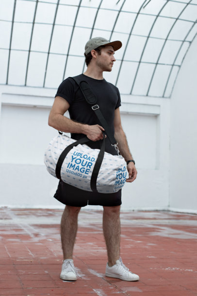 Mockup of a Sporty Man Holding a Duffle Bag 23061