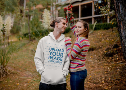 Hoodie Mockup Featuring a Couple Under Christmas Mistletoe 23511