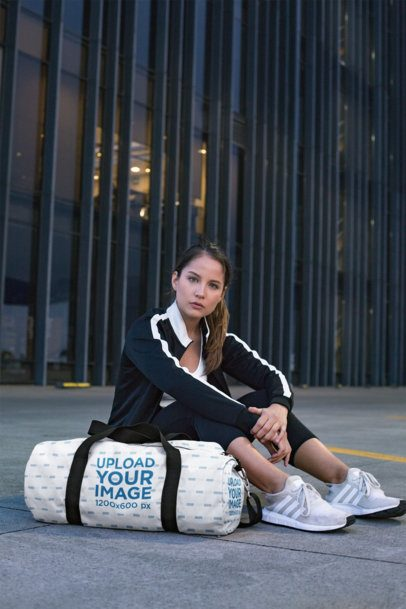 Duffle Bag Mockup Featuring a Serious Young Woman  23051