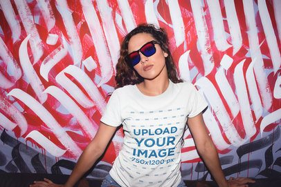 Mockup of a Trendy Woman Wearing a T-Shirt Against a Graffiti Wall 22286