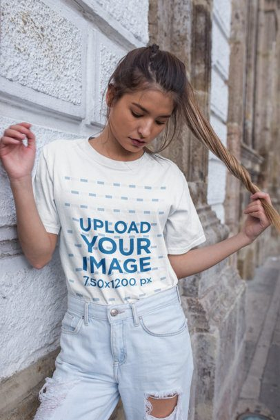 Unisex T-Shirt Mockup Featuring a Trendy Woman Wearing Distressed Jeans 22959