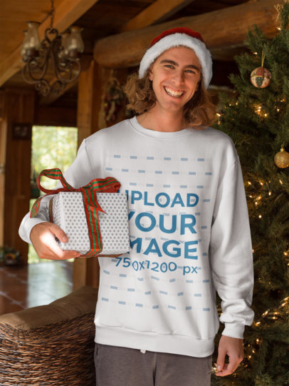 Crewneck Sweater Mockup Featuring a Man Holding His Christmas Present 23512