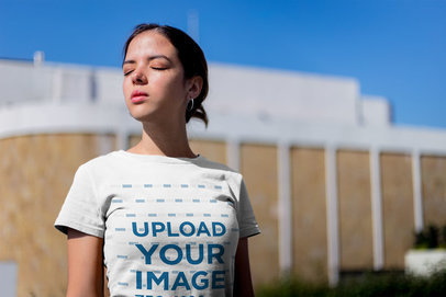 Tee Mockup of a Woman Closing Her Eyes From The Sun 20685