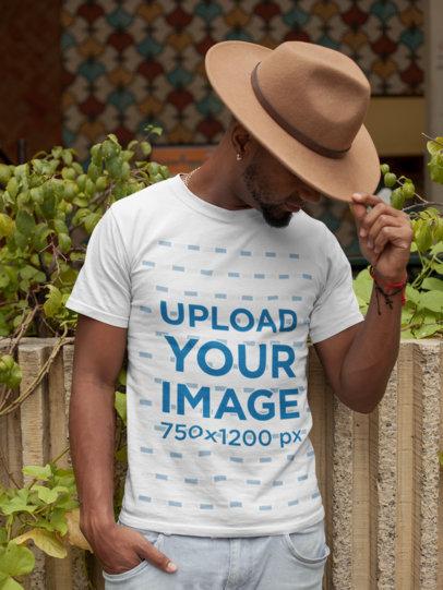 T-Shirt Mockup of a Man Wearing a Felt Western Hat 22765