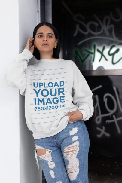 Mockup of a Brunette Woman Wearing a Sweater and Ripped Jeans 23116