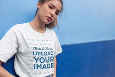Unisex T-Shirt Mockup of a Cool Girl in Front of a Blue Wall 22957