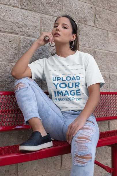 Mockup of a Trendy Woman Wearing a Unisex Tee and Distressed Jeans 23038