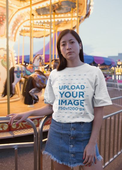 Unisex Tee Mockup Featuring a Pretty Woman Next to a Carrousel  22968