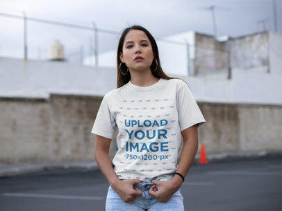 Unisex Tee Mockup of a Serious Young Woman With Hoop Earrings 23041