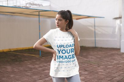 Mockup of a Woman on a Rooftop Wearing a Unisex Tee 23009