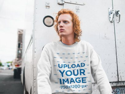 Sweatshirt Mockup Featuring a Serious Man With Red Hair Sitting on a Cargo Trailer 21204