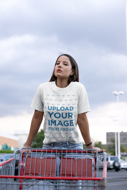 Mockup of a Woman on a Shopping Cart Wearing a Unisex Tee 23043