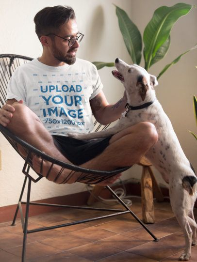 Tee Mockup of a Man Sitting on an Acapulco Chair Petting His Dog 18085
