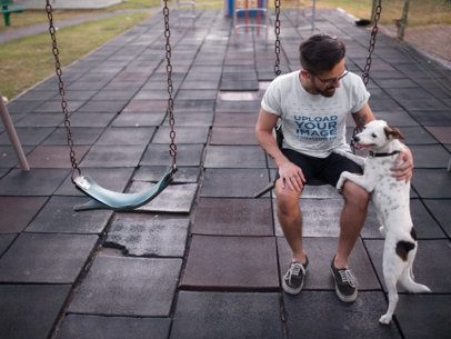 Tee Mockup Featuring a Man Petting His Dog While on a Swing 18028