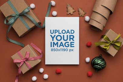 Mockup of a Beautiful Christmas Greeting Card Surrounded by Gifts 23820