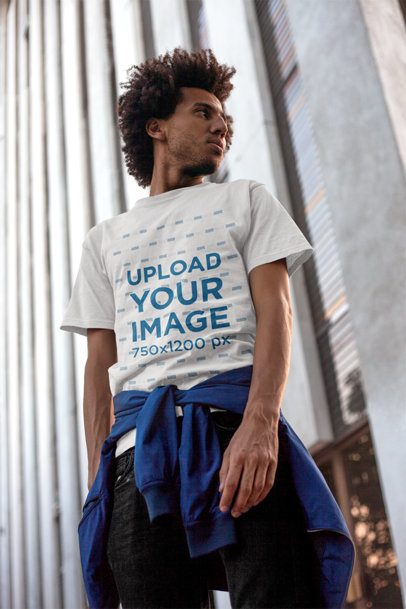 T-Shirt Mockup of a Man Standing by a City Building 18072