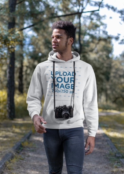 Mockup Featuring a Man Wearing a Hoodie Walking Along the Countryside 23191