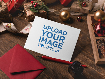 Mockup of an Xmas Greeting Card Surrounded by Christmas Decorations 23831