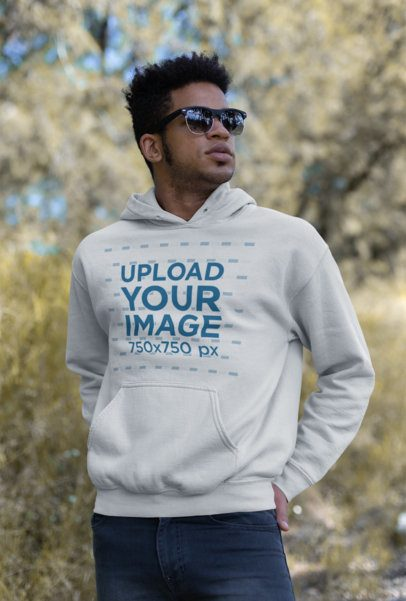 Cool Mockup Featuring a Man Wearing a Pullover Hoodie and Sunglasses Outdoors 23193
