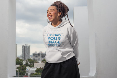 Hoodie Mockup of a Girl with Locs Having Fun on a Rooftop 23420