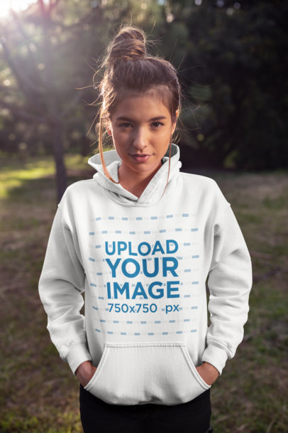 Pullover Hoodie Mockup of a Young Woman with a Cute Messy Bun Hairstyle 23276