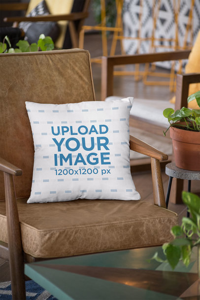 Mockup of a Square Pillow on a Leather Chair 23539
