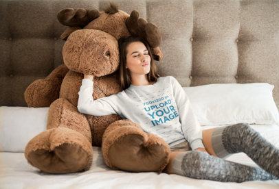 Crewneck Sweater Mockup of a Girl Cuddling with a Large Stuffed Animal 23208