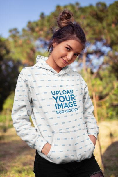 Mockup Featuring a Cute Girl Wearing a Hoodie in the Park 23283