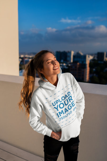 Hoodie Mockup of a Smiling Girl at a Building's Rooftop 23314