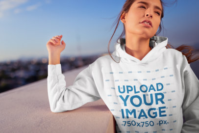 Hoodie Mockup of a Girl Watching the Sky at a Rooftop 23310