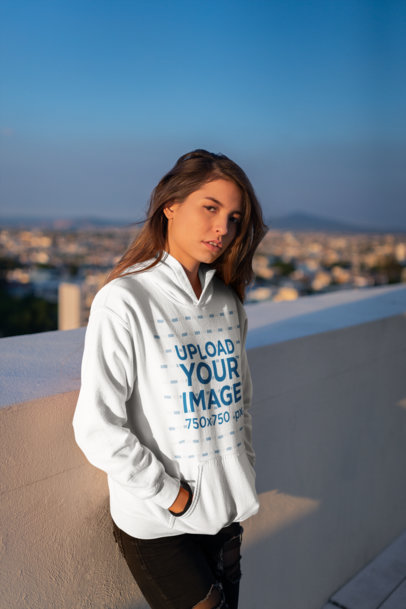 Mockup of a Serious Young Woman Wearing a Hoodie with the Sun Beaming on Her Face 23315