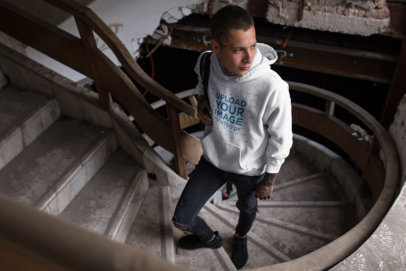 Hoodie Mockup of a Gothic Man Going Up an Abandoned Stairwell 23432