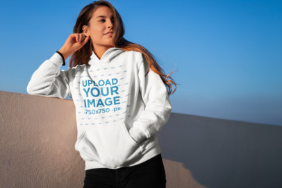 Hoodie Mockup of a Smiling Young Woman on a Rooftop 23316