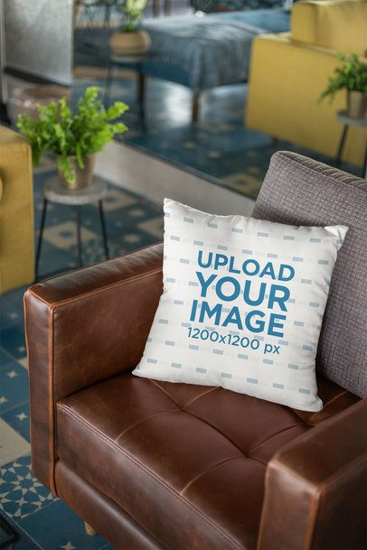 Throw Pillow Mockup Lying Over a Retro Leather Couch 23555