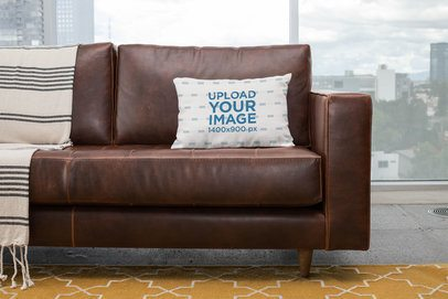 Mockup of a Pillow on a Sofa with the City on the Background 23556