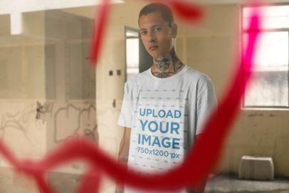 Tee Mockup of a Punk Man With Tattoos Behind a Graffiti on a Window 23460