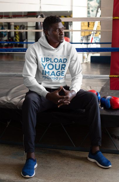 Hoodie Mockup of a Man Sitting Beside a Boxing Ring 23623