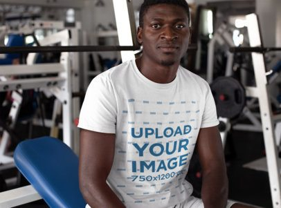 T-Shirt Mockup of a Man Resting Between Sets at the Gym 23634