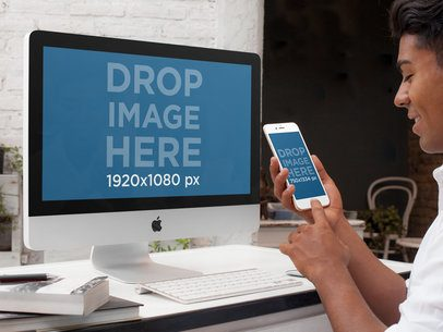 Mockup of a Young Designer Working on an iMac and Using an iPhone a4893