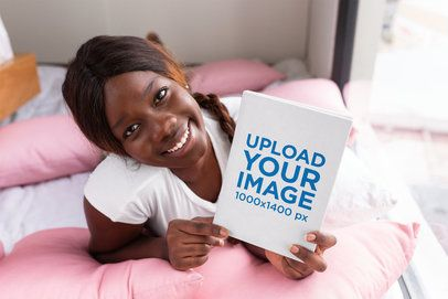 Book Mockup of a Smiling Woman on Her Bed 23708
