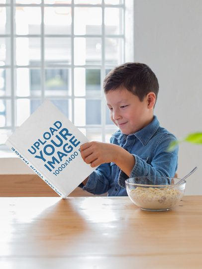 Mockup of a Happy Young Boy Reading His Book at a Table 23715